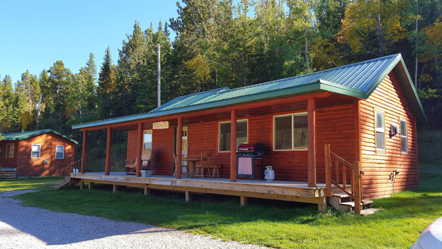 This 2 bedroom cabin sleeps a maximum of 8 with a queen hide a bed couch in  the living area  A small ladder accessible loft is best for younger adults  or. Deluxe Cabins